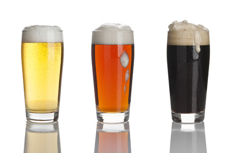 glasses of lager beer, dark beer and stout Stock Photo