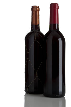 two bottles of red wine, Bordeaux and Rioja Riserva, isolated on white background photo
