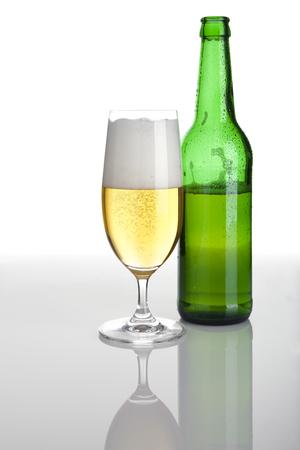 glass half full: beer glass half full, beer bottle half empty