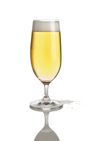 pilsener: glass of pilsener beer with puddle  isolated Stock Photo