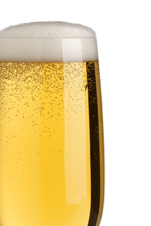 pilsener: closeup of fresh pilsener beer with froth, isolated on white