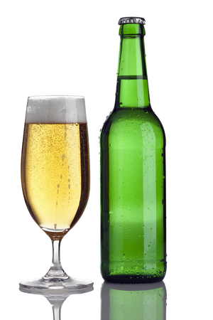 pilsener: closed green bottle and glass with fresh pilsener beer isolated on white