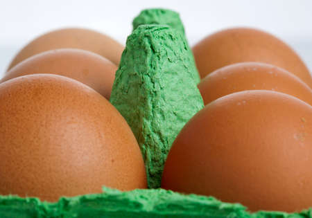 cloesup: cloesup of six brown eggs in green cardboard box Stock Photo
