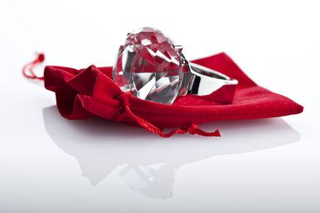 mockery: fake diamond ring on red velvet pouch Stock Photo