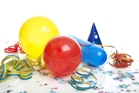 ballons, streamers, party hat and confetti on white background
