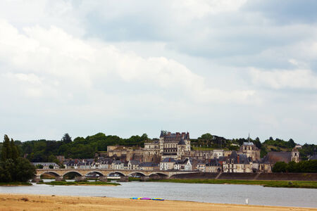 city and castle of Amboise, river Loire in foreground