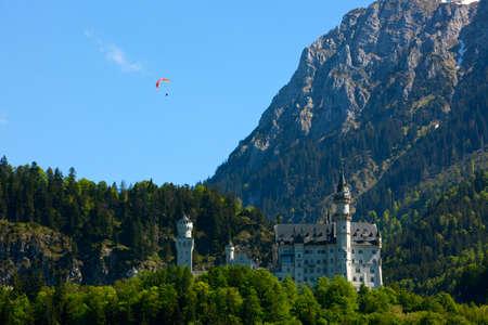 paraglider: paraglider above Neuschwanstein Castle Editorial