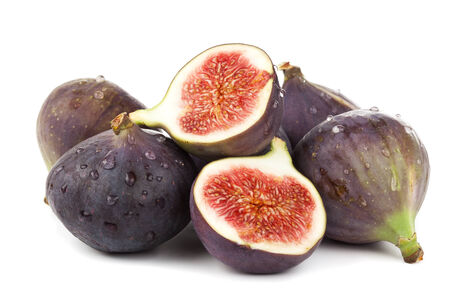 fresh figs, whole and halves, stacked on whitze background photo