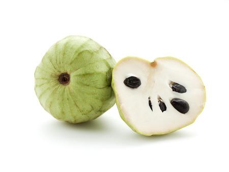 whole and half Cherimoya fruit isolated on white