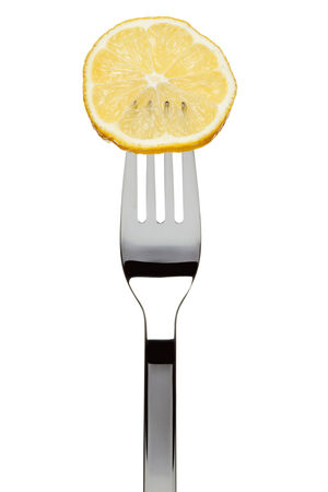 tine: slice of lemon sticked on fork, isolated on white