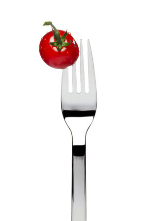 tine: fresh cherry tomato sticked on fork, isolated on white Stock Photo