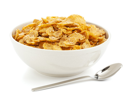 sugarcoated: bowl of sugar-coated corn flakes and spoon isolated on white