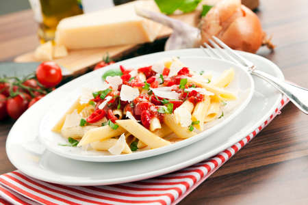 tilted view: pasta arrabbiata meal surrounded by ingredients, tilted view