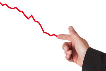 nger: businessman drawing downward graph with his fínger Stock Photo