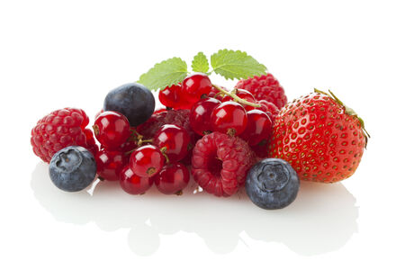 variety of berry fruit isolated on white photo