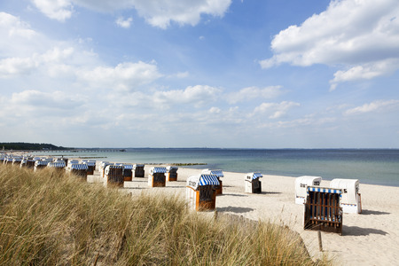 shore: beach chairs, so-called Strandkorbs, at Timmendorfer Strand on the german baltic sea shore