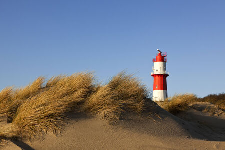 dunes and small lighthouse at south beach of Borkum island