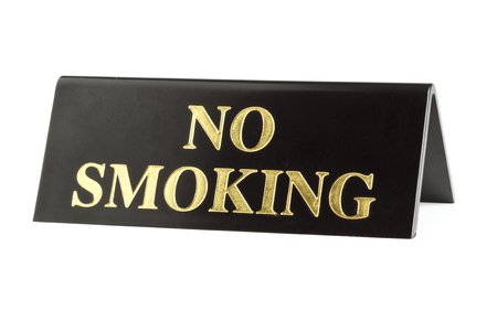 gritty: gritty old no smoking sign with golden letters isolated on white