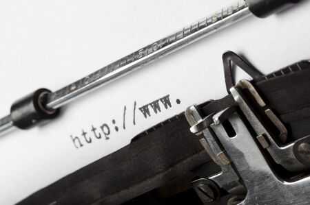 tilted view: beginning of URL written on old typewriter, tilted view, shallow depth of field