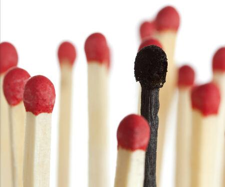 burnt match between new matchsticks, shallow depth of field Stockfoto