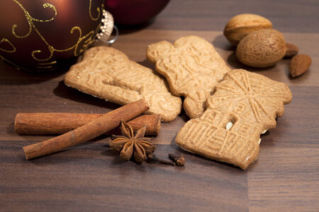 speculaas: traditional dutch speculaas christmas biscuits, ingredients and baubles