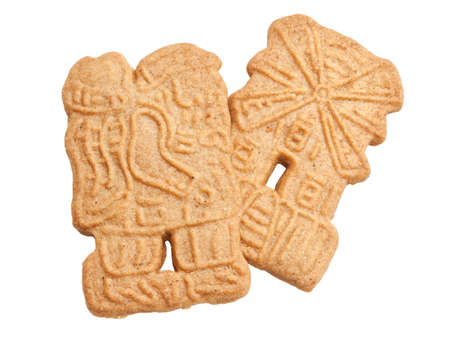 speculaas: Two Speculaas cookies in Santa Claus and Windmill shapes isolated