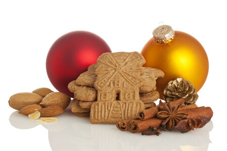 Speculaas biscuits surrounded by christmas decoration and spices photo