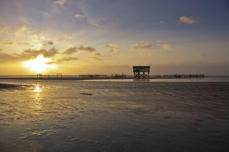 wadden sea: Sunset at a beach of the northern german wadden sea