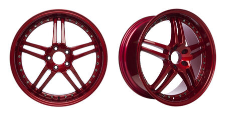 Front view and slightly rotated view of glossy red coated alloy wheels isolated on white background