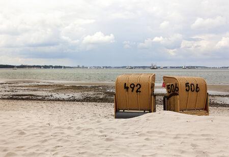 kiel: two beach chairs at the baltic sea beach near Kiel Stock Photo