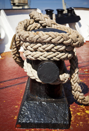 cleat: strong rope wrapped around cleat on ship
