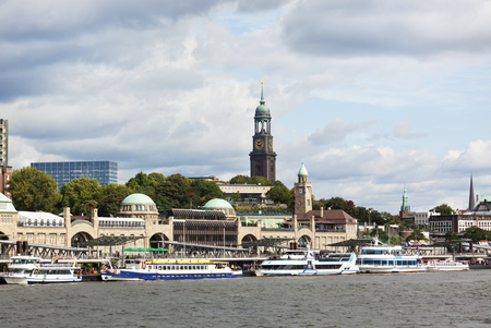 hamburg: St. Pauli Landing Stages, the floating piers at Hamburg harbor, and St. Michaelis Church