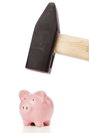 heavy sledgehammer above small pink piggy bank on white background photo