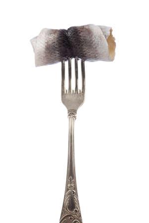 kipper: Rolled kipper on silver fork isolated