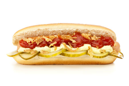 original Danish Hot dog with pickled cucumber slices, fried onions, ketchup and mayonnaise isolated on white background