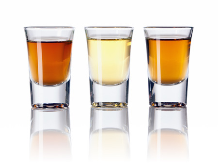 Three kinds of alcoholic drinks in shot glasses