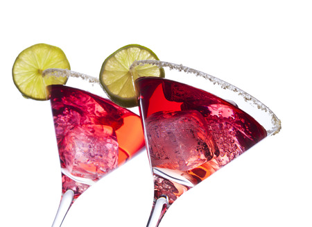 tilted: Two pink cocktails, low tilted view, isolated on white background