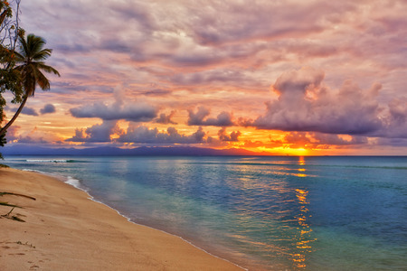 Vibrant sunset at caribbean island beach