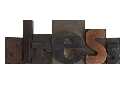 word stress in vintage wooden letterpress type, scratched and stained, isolated on white background photo