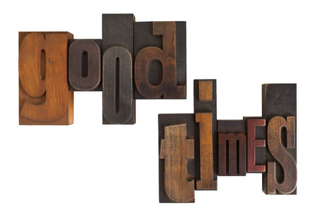 good times: phrase good times written in vintage wooden letterpress type, scratched and stained, isolated on white