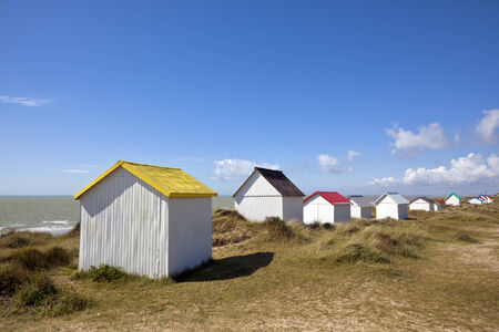 manche: Beach cabins in the dunes of Gouville-Sur-Mer at the western coast of Cotentin peninsula, Manche region, Basse-Normandie