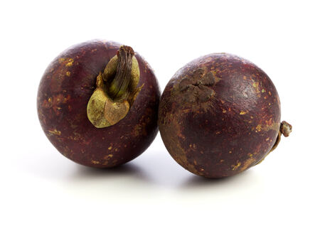 Two Purple Mangosteen Fruit isolated photo