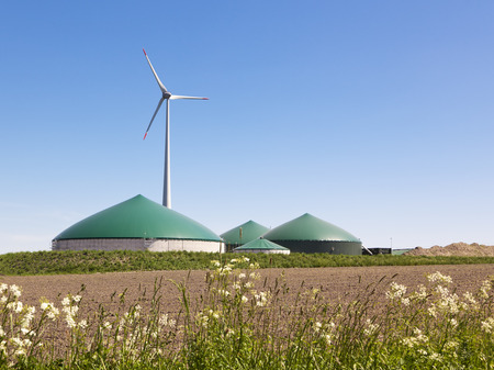 Biogas plant and wind turbine in rural Germany