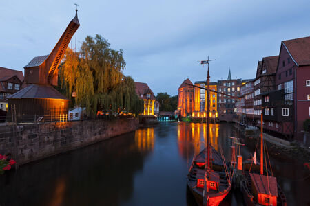 watermills: Historic harbor of Luneburg with old Crane and Watermills at night