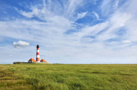 german north sea region: The lighthouse of Westerhever on the german north sea coast