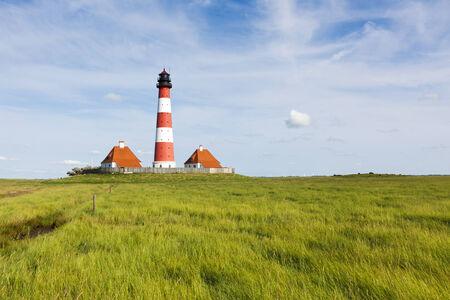 german north sea region: The lighthouse of Westerhever on the german north sea coast