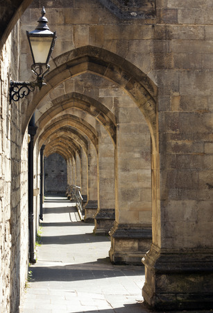 winchester: Archway outside of Winchester Cathedral, Hampshire, England