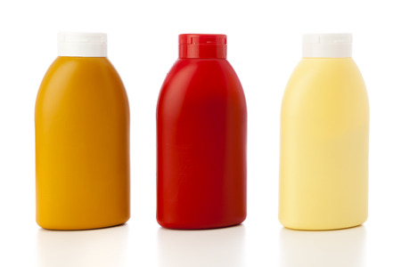 mustard, ketchup and mayonnaise in plastic bottles isolated on white photo