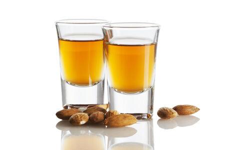 amaretto: Italian Amaretto liquor and almonds isolated on white