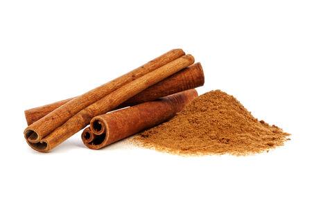 Cinnamon sticks and powder on white background photo